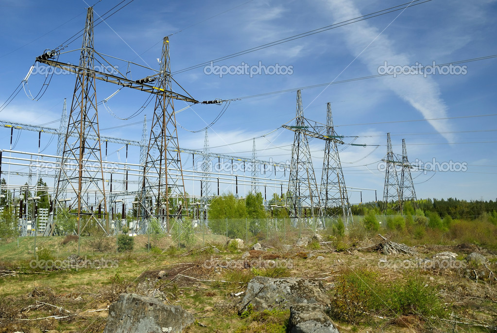 Industrial landscape with power station towers and electric wires — Stock Photo #5735158
