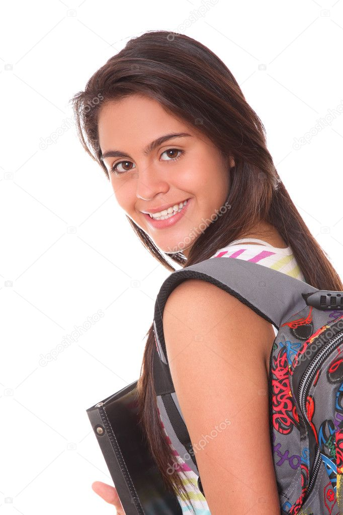 Girl student with a briefcase in the back and books in her hands  Stock Photo #5642647