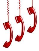 Hanging rotary telephone hand — Stock Photo