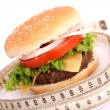 Hamburger and measuring tape — Stock Photo