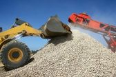 Stone Pile and Machines — Stock Photo