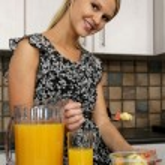 Pretty Blond Woman Eating Breakfast — Stock Photo