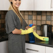 Stock Photo: Petty Blonde Housewife Cleaning Kitchen