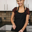 Stock Photo: Gorgeous Blond Lady Preparing Vegetables