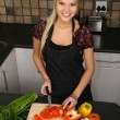 Stock Photo: Gorgeous Blond Woman Cutting Vegetables