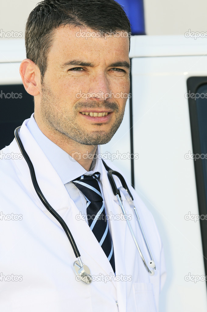 Portrait of doctor in front of an ambulance  Stock Photo #5414663
