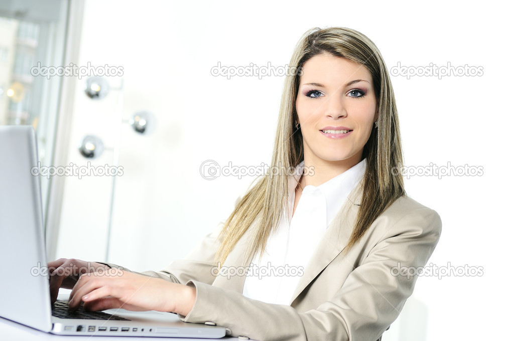 Closeup of businesswoman in the office  Stock Photo #5473785