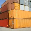 Cargo freight containers at harbor terminal - Stock Photo