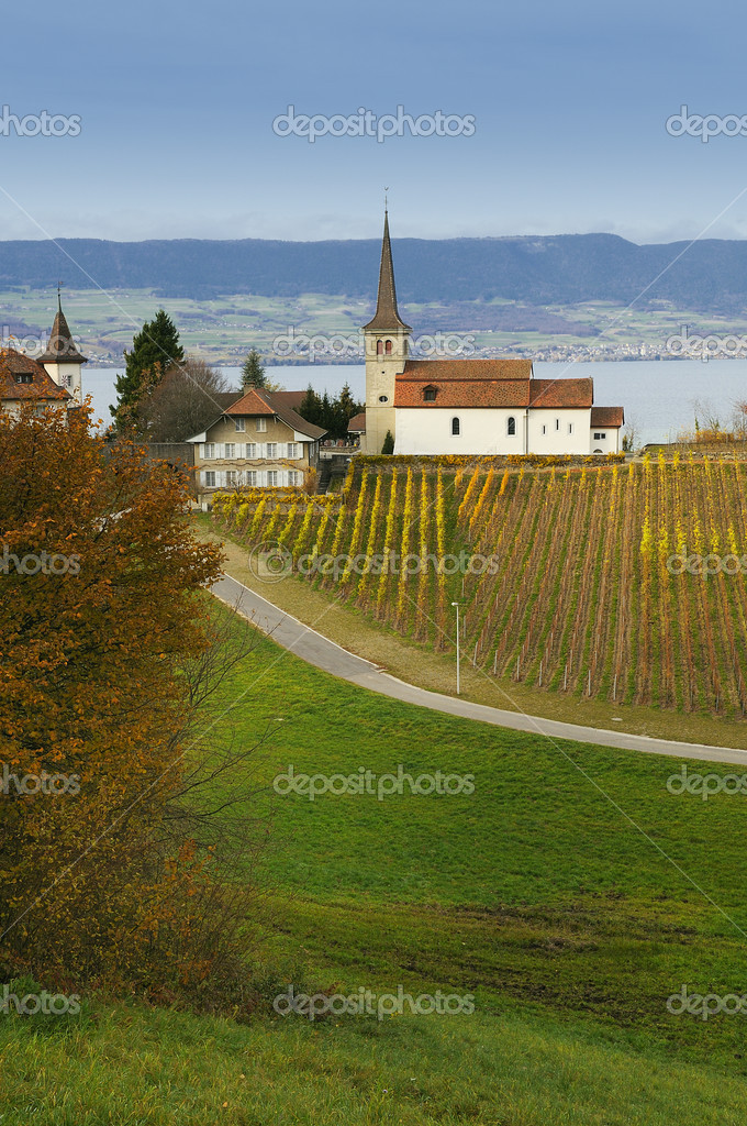 A small church is located above Lake Neuchatel, Switzerland. — Stock Photo #6285745