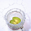 Fruit drop in water — Stock Photo