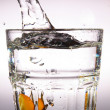 Stock Photo: Fruit drop in water