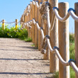 Pathway with wood post fence - Stock Photo