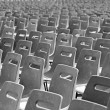 Multiple chairs in rows — Stock Photo