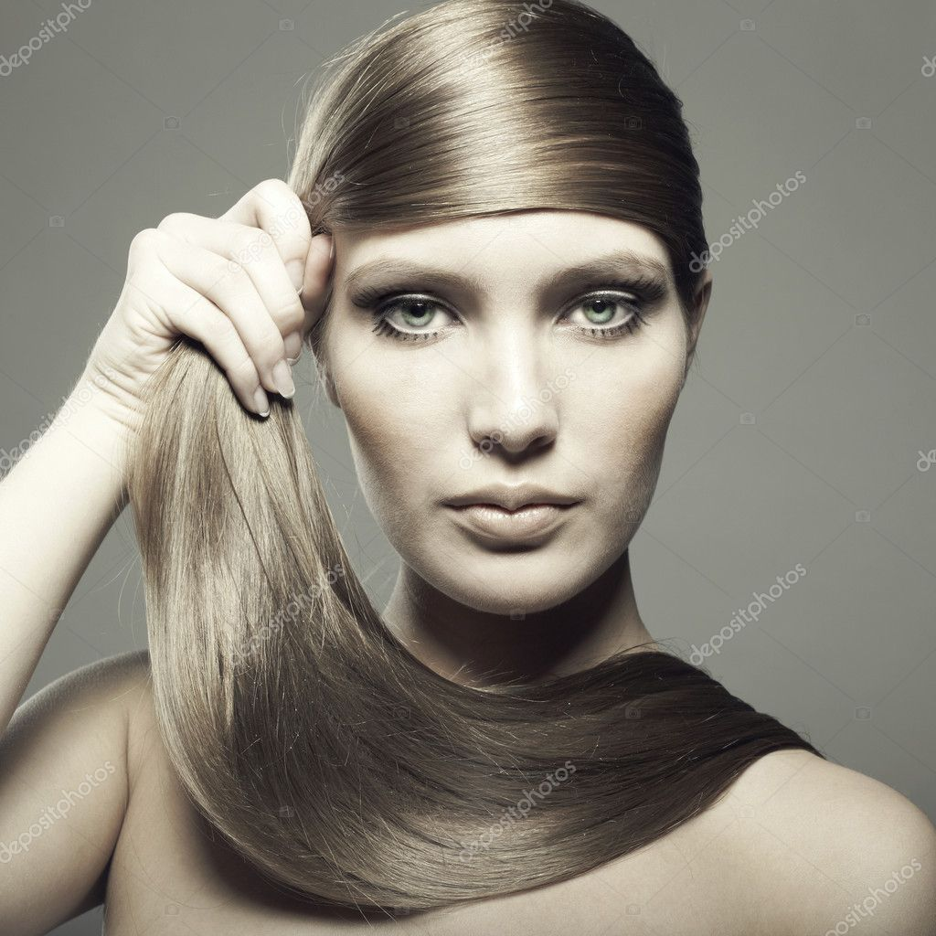 Photo of young beautiful woman with magnificent hair — Stock Photo #5467715