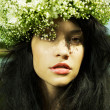 Beautiful girl wearing a wreath of wildflowers - Stock Photo