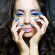 Beautiful woman with bright makeup and manicure — Stockfoto