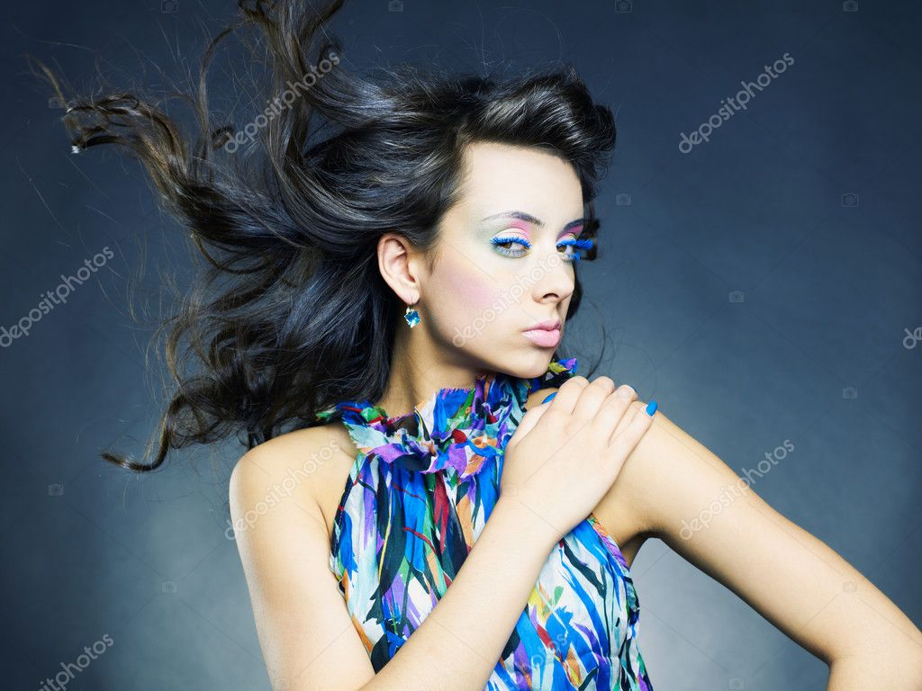 Photo of a young beautiful woman with bright makeup and manicure — Stockfoto #5846585