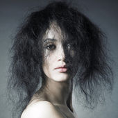 Sensual lady with magnificent bushy hair — Stock Photo