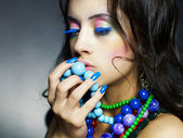 Beautiful girl with bright beads — Stockfoto