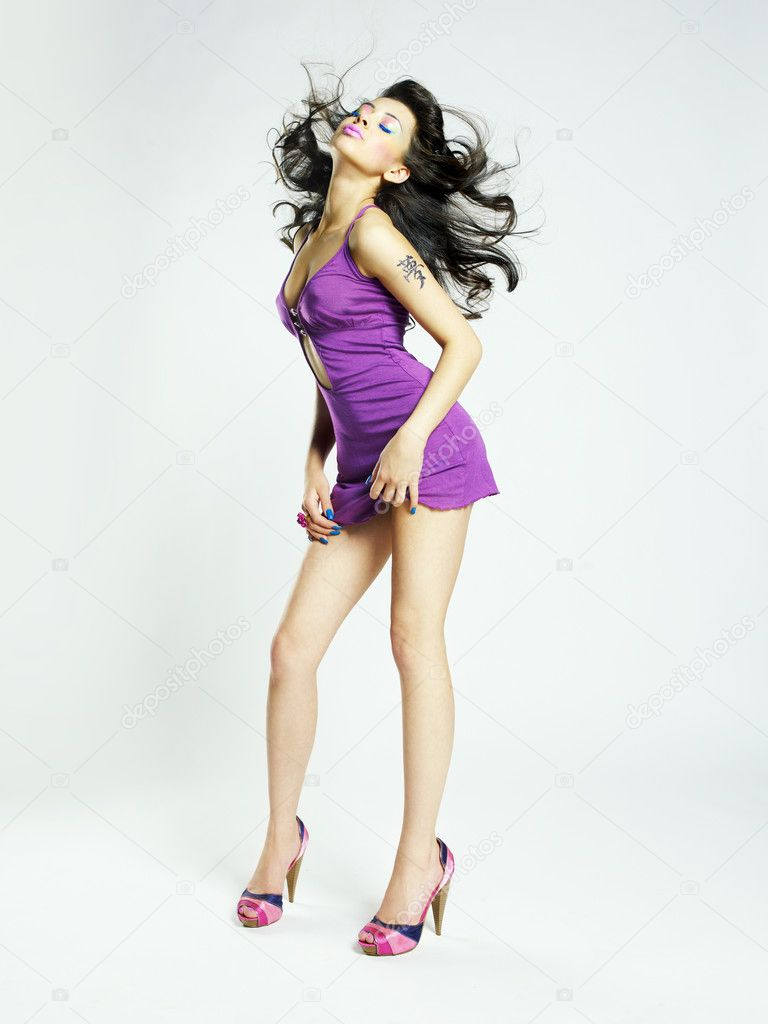 Fashion photo of young magnificent woman in lilac dress — Stock Photo #5964432