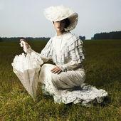 Woman in vintage dress — Zdjęcie stockowe
