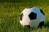 Soccer ball on grass — Stock Photo