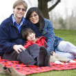 Handsome father sitting at park with disabled son — Stock Photo