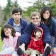Happy interracial family enjoying a day at the park — Stockfoto