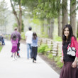 Beautiful teenage girl out on walk with family — Stock Photo #6104873
