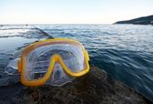 Mask for diving at breakwater — Stock Photo