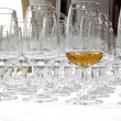 Empty whisky glasses with one filled glass — Stock Photo