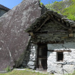 House build in rock in Ticino mountains — Stock Photo