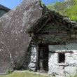 Stock Photo: House build in rock in Ticino mountains