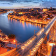 Porto, river Duoro and bridge at night - Stock Photo