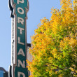 Royalty-Free Stock Photo: Portland Oregon neon sign with fall trees