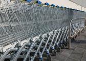 Row of shopping carts — Stock Photo