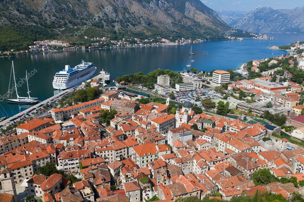 Historic town of Kotor in UNESCO World Heritage Site bay of Kotor with high mountains plunge into adriatic sea, Montenegro — Stock Photo #6713461