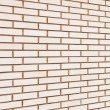 Royalty-Free Stock Photo: Beige colored fine brick wall texture background perspective, la