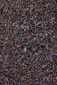 詳細な黒茶葉のテクスチャの背景 — ストック写真