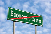 End Of Economic Crisis Green Road Sign Against Light Cloudscape — Stock Photo
