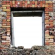 Ruined rustic limestone boulder rubble wall window frame - Stock Photo