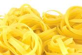 Fettuccini pasta macro closeup aislado — Foto de Stock