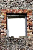 Ruined rustic limestone boulder rubble wall window frame — Stock Photo
