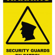 Stock Photo: Security guards on patrol warning text sign, isolated