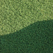 Royalty-Free Stock Photo: Artificial grass fake turf synthetic lawn field macro closeup