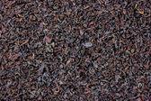 Detailed Black Loose Tea Leaf Texture Background — Stock Photo