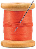 Old wooden bobbin with red thread isolated — Foto Stock