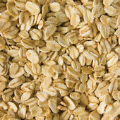 Oatmeal background, rolled raw oats macro closeup — Stock Photo