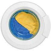 Mycie drzwi maszyny, czyste kolorowe ubrania, żółty, niebieski pluszowa — Zdjęcie stockowe