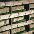 Stock Photo: Horizontal Weathered Wooden Fence Panel In Grass